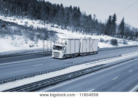 truck transport in snowy winter