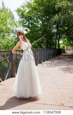 portrait of a beautiful girl on the bridge
