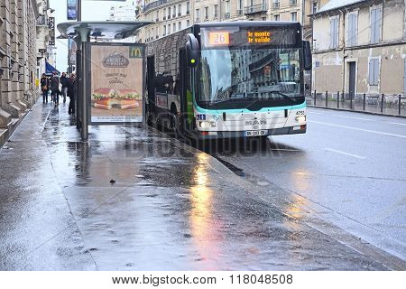 Paris, France, February 9, 2016: Bus  stop on the street of Paris, France