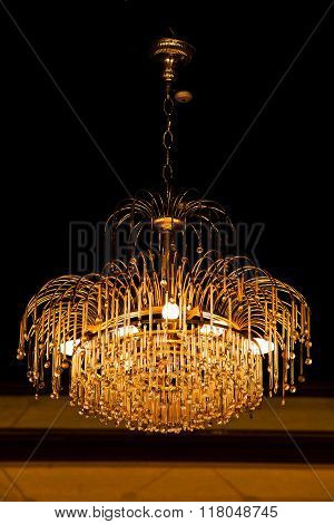 Beautiful elegant crystal chandelier in hotel for background