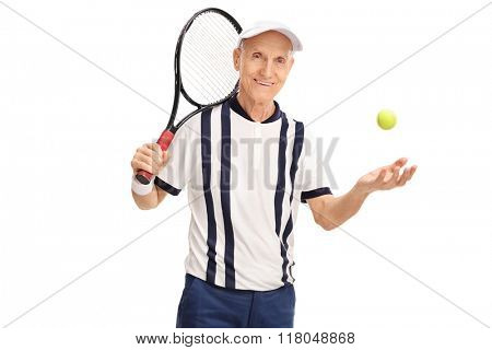 Senior tennis layer holding a racket and throwing the ball isolated on white background