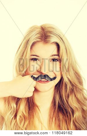 Blonde student with mustache looking at camera