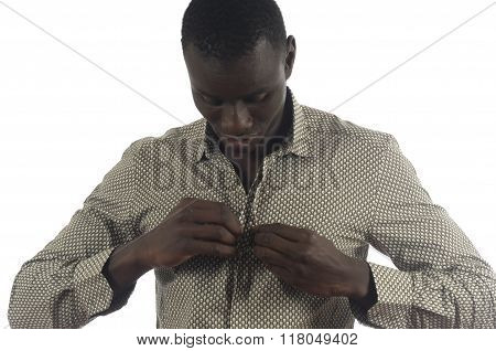 Portrait of an African man taking off his shirt