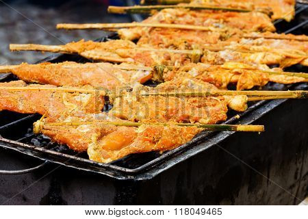 Grilling chicken plugged with bamboo Local Foods of Thailand