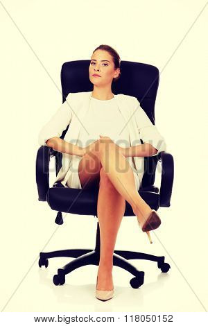 Confident businesswoman sitting on armchair
