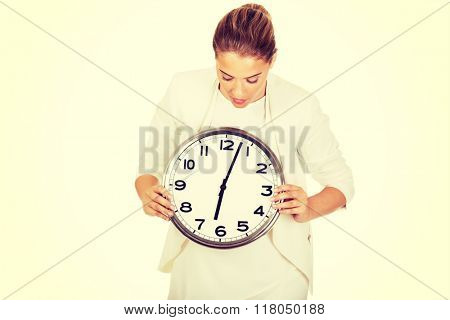Businesswoman with clock- time concept