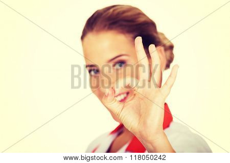 Young smile female nurse or doctor gesturing