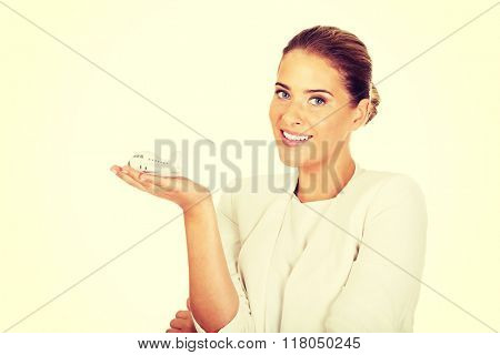 Beautiful businesswoman holding airplane model