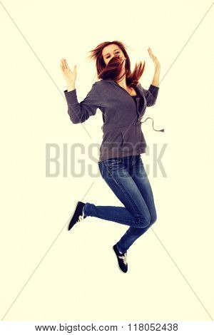 Teenage happy woman jumping in the air