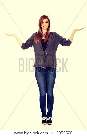 Teenage woman presenting something on open palms