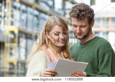 Couple With Blueprint Project Keys On Construction Site