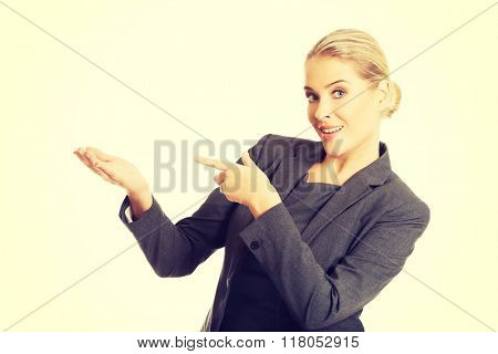 Businesswoman showing copy space on the left