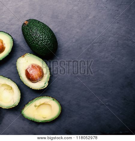 Avocado On A Black Background, Top View Image. Halved Avocado, Close Up