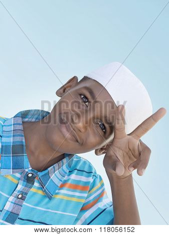 Twelve-year-old boy making the victory sign with his hand