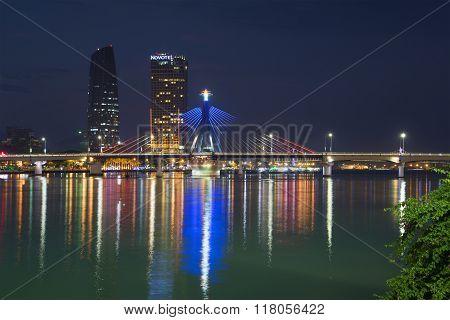 The south bridge and high-rise buildings at night Danang. Vietnam