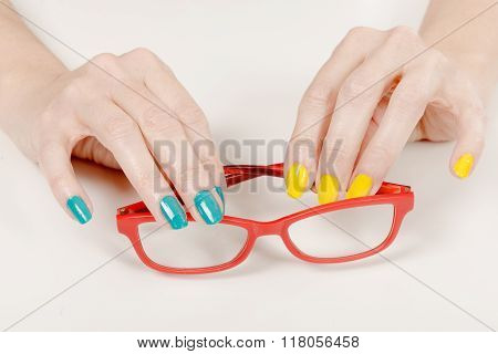 Woman Hands With Red Glasses