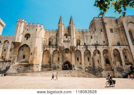 People walking near ancient Popes Palace, Saint-Benezet, Avignon