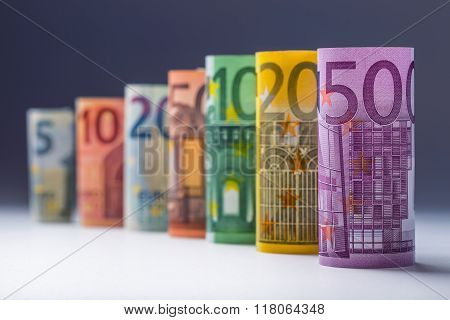 Several hundred euro banknotes stacked by value.Rolls Euro  banknotes.Euro currency money.