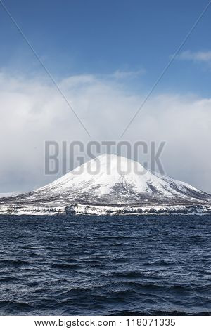 volcano in the winter on the island in the clouds