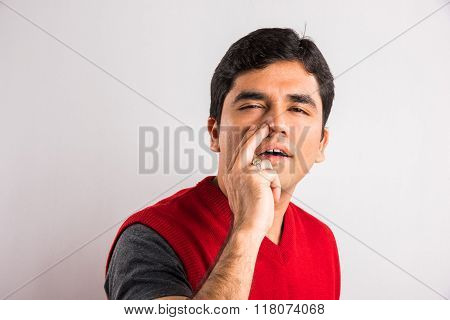 indian man with choked nostril, choked nose, indian man having congestion in nostril