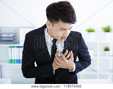 Young Businessman Having Heart Attack And Chest Pain
