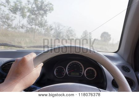 Hands On Steering Wheel, Inside Car ,drive In Desolate