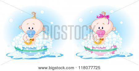 Cute Babies (boy and girl) taking a bath