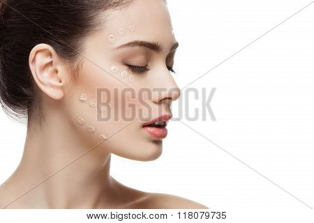 Girl with foundation cream on face