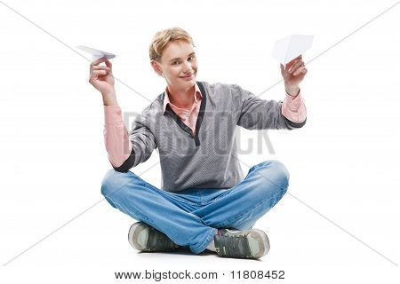 Happy Man Throwing A Paper Plane