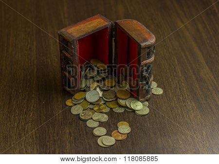 Treasure chest with old russian coin and have a wood floor in the background