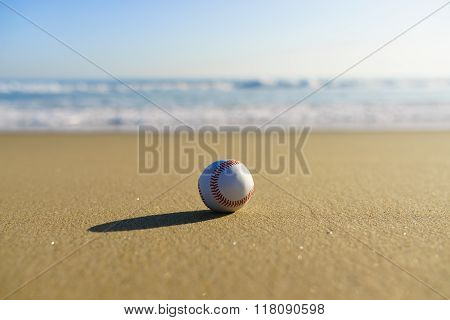 Baseball At A California Beach With White Wave In Pacific Ocean