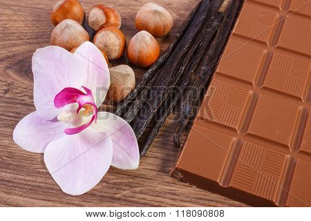 Milk Chocolate, Fragrant Vanilla Sticks With Hazelnut And Blooming Orchid