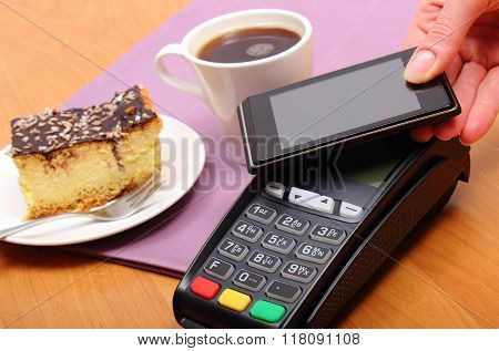 Paying With Mobile Phone With Nfc Technology For Cheesecake And Coffee In Cafe, Finance Concept