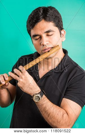 indian man playing flute, asian man playing flute, indian musician, indian man and flute, asian man