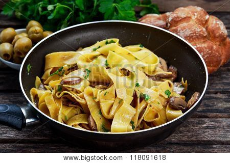 Pappardelle Pasta with mushrooms and other herbs. in wok.