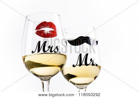 Two wine glasses with wine isolated on a white background. Glasses for woman and man. White wine.