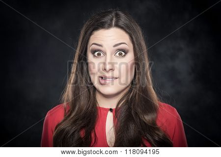 Amazed girl bit her lip.