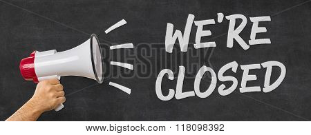 A Man Holding A Megaphone - We Are Closed