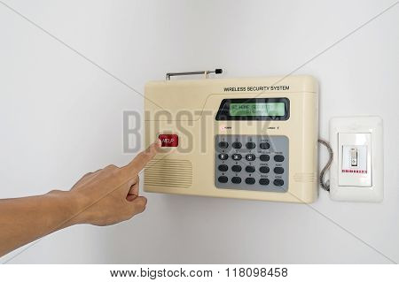 Home security system with hand pushing red button