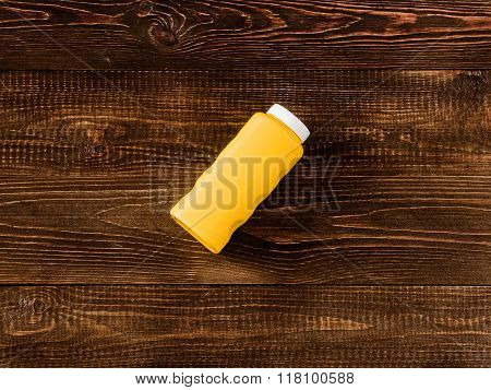 Baby talcum powder container on dark wooden background. Flat lay