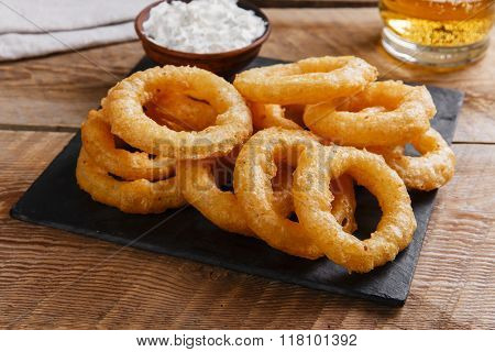 fried onion rings in batter with sauce