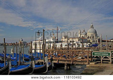 Venice, Italy - September 02, 2012: The Basilica Santa Maria Della Salute And Parked Gondolas In Ven