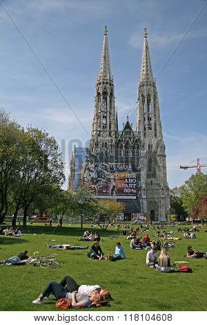 Vienna, Austria - April 22, 2010: Young People Relaxing On The Grass Of Sigmund Freud Park Near The