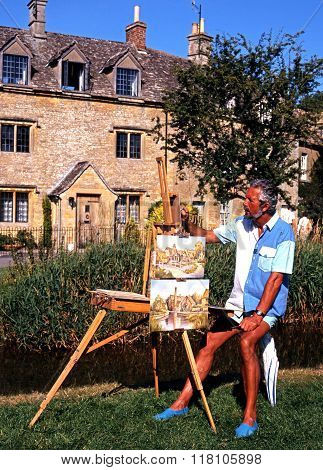 Artist painting scenes in Lower Slaughter.