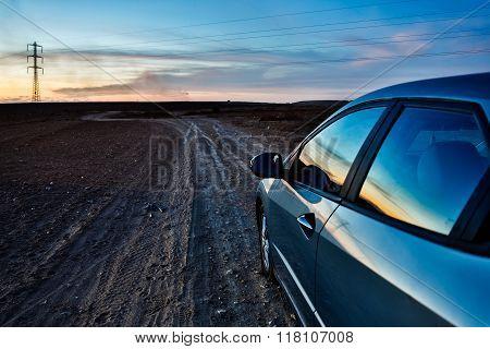 Car Goes On Stony Desert