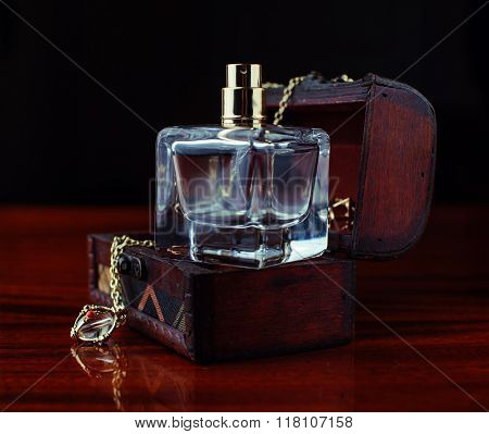 Perfume And Casket With Jewelry