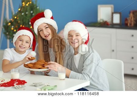 Happy children have a meal in decorated Christmas room
