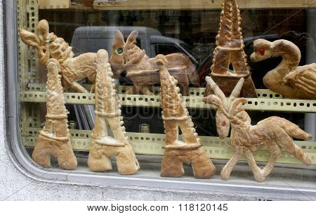Assortment of unusual pastries in window of Parisian bakery