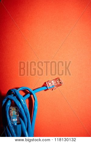 Blue network cable on red background