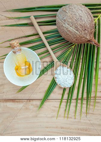 Coconut Oil Coconut Powder And Coconut On Coconut Leaves Set Up On Brown Wooden Background For Alt